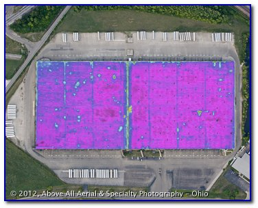 An aerial infrared roof scan reveals areas where moisture is trapped in a flat, built up roof (BUR).