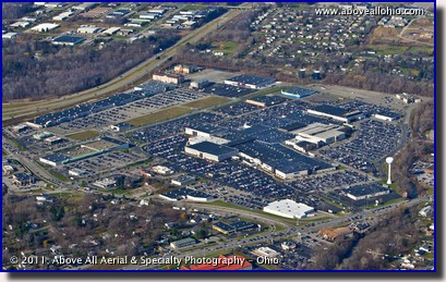 An oblique aerial view of a shopping mall in Erie, PA, packed with shoppers on Black Friday, 2011