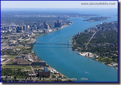 Aerial photograph of downtown Detroit, Michigan, the Ambassador Bridge, the Detroit River, Belle Isle, and Windsor, Ontario, Canada