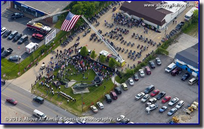 Local fire departments join together to raise a huge American Flag over the entrance to the Medina (Ohio) VFW post during a Wounded Warrior Project fundraising event.