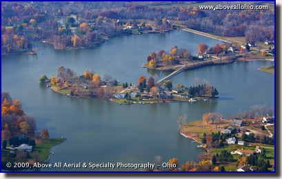 A somewhat low and close up aerial view of an island in Holiday Lakes near Willard, OH
