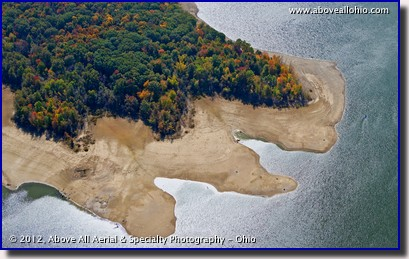 A close up aerial view of fall colors at the edge of a drought-stricken lake near Youngstown, OH.