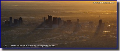 The sun rises over Columbus, OH, in this aerial panoramic view from the southwest side of the city.