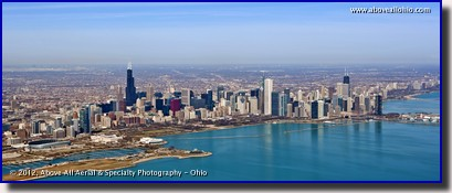 An aerial panoramic photo of the Chicago, IL, skyline; looking west over Lake Michigan towards downtown.