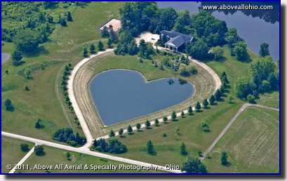 An aerial view of a unique heart shaped pond in front of a residential property; near Cleveland, Ohio.