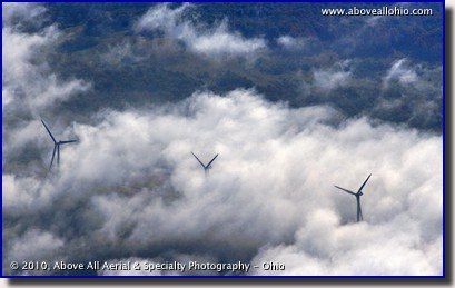 Aerial photograph of early morning fog obscuring wind turbines on a mountain ridge in West Viriginia