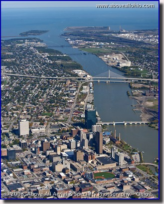An aerial portrait of Toledo, Ohio, the Maumee River, and Lake Erie.