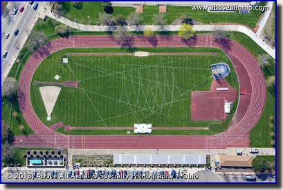 A steep oblique aerial view of a track and associated field event markings at the University of Akron (Ohio).