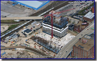 An aerial view of a new lake-side office building called the Flats East Bank, under construction in downtown Cleveland, OH