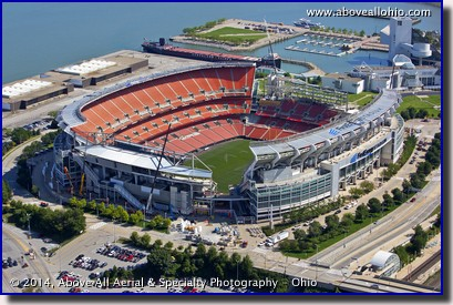 A low and close helicopter aerial view of construction going on at First Energy Stadium, home of the Cleveland Browns.