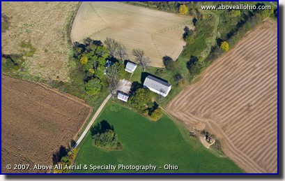 An aerial photo of a small farm house and surrounding land in the early fall. Medina County, Ohio