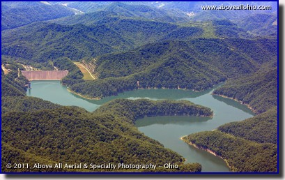 An aerial photo of a mountain reservoir and dam in southern West Virginia