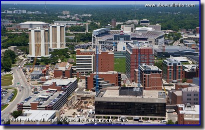 An aerial view of multiple construction projects on the Ohio State University medical campus taken at a very low altitude by helicopter, Columbus, Ohio
