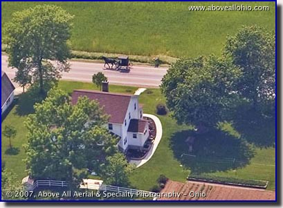Aerial photo of of a horse and buggy traversing Ohio's Amish country