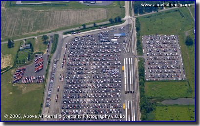 Aerial photo of new cars waiting to be loaded on trucks and rail cars