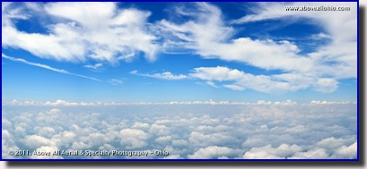 An airborne very high resolution panoramic view of the blue sky between two layers of clouds