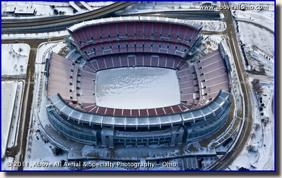 An aerial view looking into Cleveland Browns Stadium, full of snow and ice; downtown Cleveland, Ohio