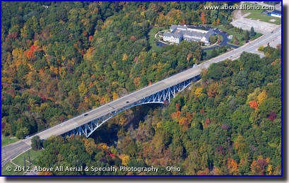 An aerial view of fall colors and the Main St bridge over the Cuyahoga River in Cuyahoga Falls, Ohio.
