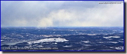 A panoramic aerial view of winter skies and distant snow near Pittsburgh, Pennsylvania