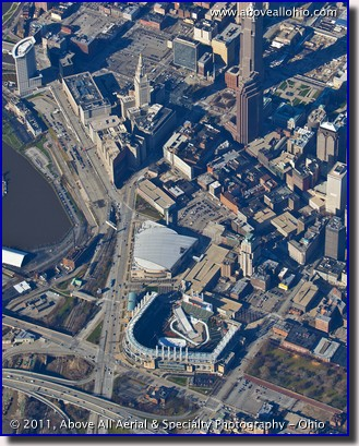 "A high altitude aerial photo of downtown Cleveland, OH, with Progressive Field set up for ""Snow Days"""