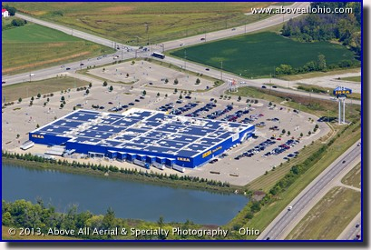 A shallow angle oblique aerial view of solar panels on the roof of an Ikea store near Cincinnati, Ohio.