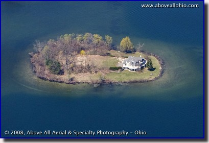 Aerial view of a residential lake island property