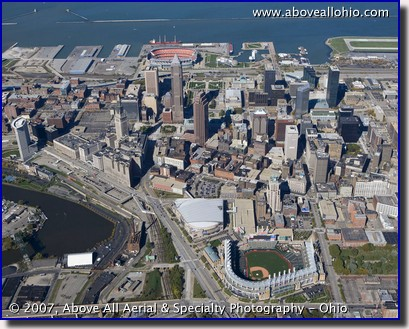Progressive Field - formerly Jacobs Field - and downtown Cleveland Ohio. Cleveland Stadium is also visible in the background of this aerial photo.