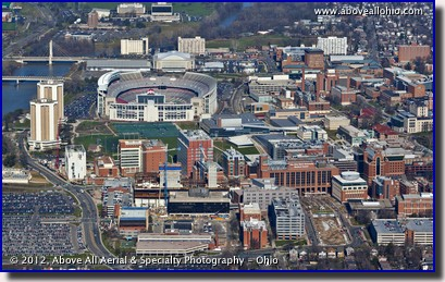A low angle oblique aerial view of Ohio Stadium and part of The Ohio State University campus, Columbus, Ohio.