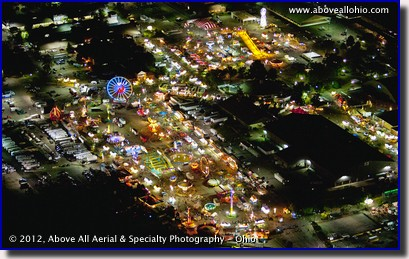 A night time aerial photo of the midway rides at the Ohio State Fair in Columbus, OH.