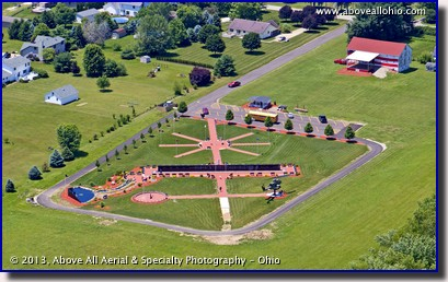 A low level aerial view of Ohio Veterans' Memorial Park in Clinton, OH, taken by helicopter.