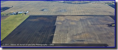 A panoramic aerial view of a farmer perparing a field for spring planting in rural Ohio