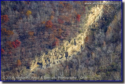 A close up aerial view of a cliff at a former mining site near Coshocton, Ohio, and a little lingering fall color.