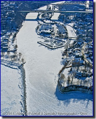 Aerial view of the Rocky River (Ohio) inlet and marina on a frozen Lake Erie
