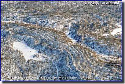 A winter aerial view of some unusal land features, visible only when the leaves are off of the trees; near Cadiz, in east-central Ohio.