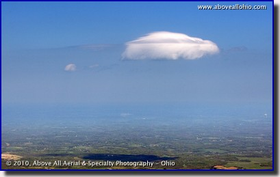 An air-to-air aerial view of a lone cloud somewhere over rural Ohio.