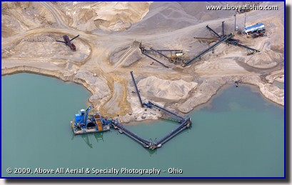 Aerial photo of a quarry, lake, and conveyeying equipment