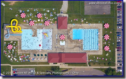 A near vertical aerial view of a couple of busy swimming pools near Mount Vernon, Ohio.