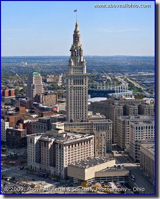 A low level aerial view of the Terminal Tower in downtown Cleveland, Ohio, taken by helicopter in early fall