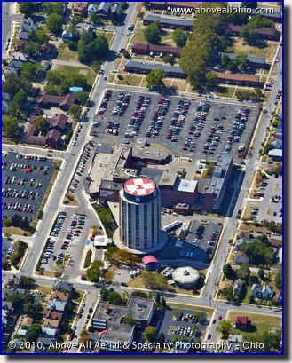 An oblique aerial view of the heliport on top of Ohio State's University Hospital East tower, just east of downtown Columbus, OH.