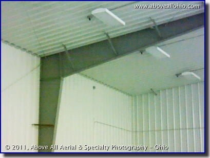 A regular photograph of an inside corner of a refrigerated metal building