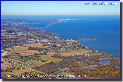 A wide angle aerial view of northern Ohio's Lake Erie coast line showing Huron, Sandusky, Cedar Point, Port Clinton, and the Lake Erie Islands.