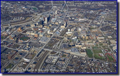A wide-angle, high oblique aerial photo of downtown Akron, OH.