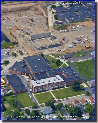 An aerial portrait of a new high school being built to replace the existing one (in the foreground) in Willard, OH.