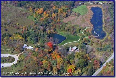 An aerial photo of beautiful fall colors in the the Medina (OH) County park known as the Alderfer-Oenslager Wildlife Sanctuary / Wolf Creek Environmental Center.